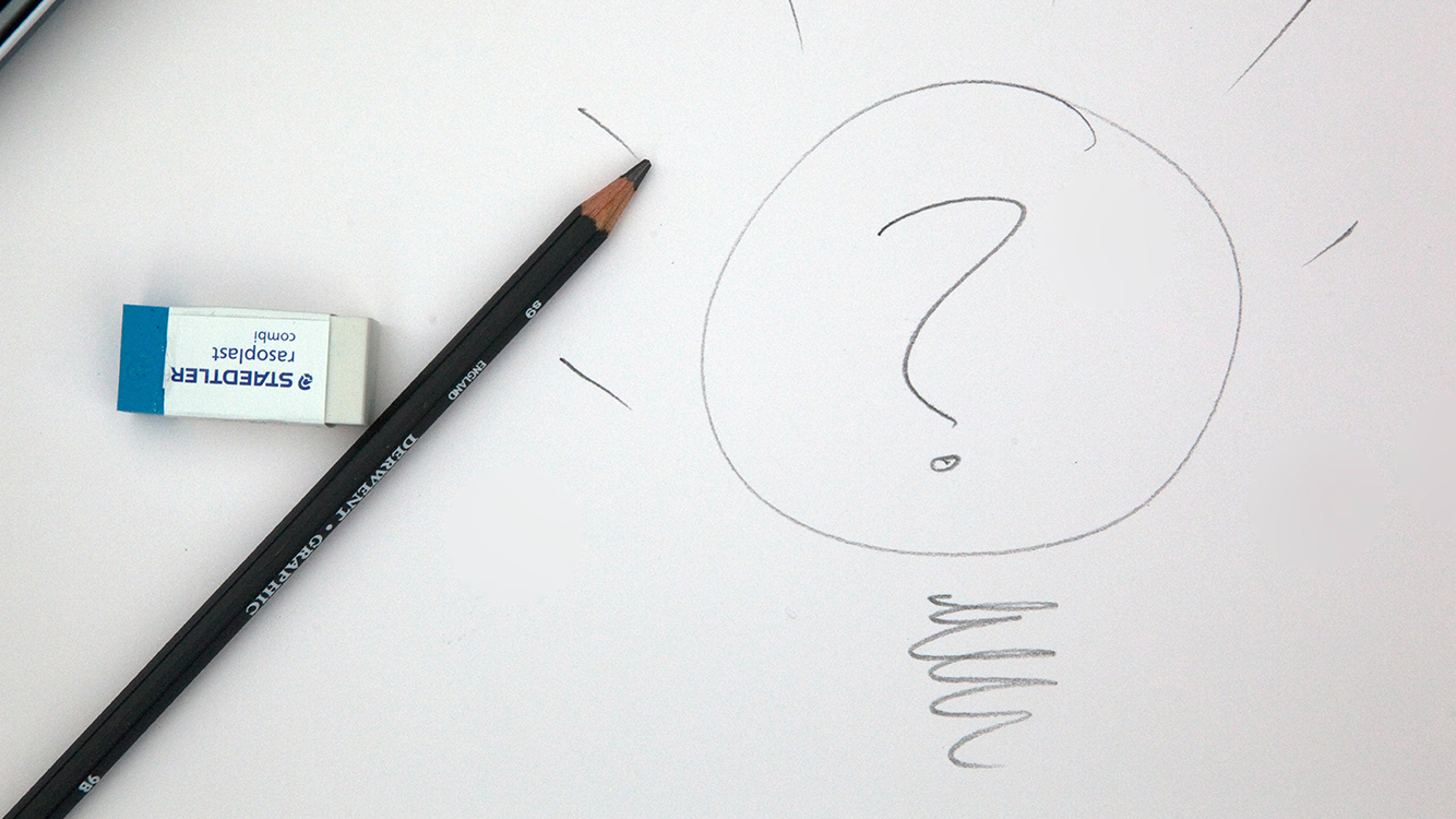 A drawing of a lightbulb with a question mark in it.